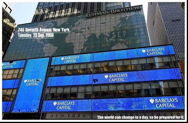 Signs are displayed on the former Lehman Brothers, now Barclays Capital building in Times Square in New York...Signs are displayed on the former Lehman Brothers, now Barclays Capital building in Times Square in New York September 23, 2008. REUTERS/Eric Thayer (UNITED STATES)